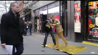 Street Performer Attacks Member Of The Public Prank
