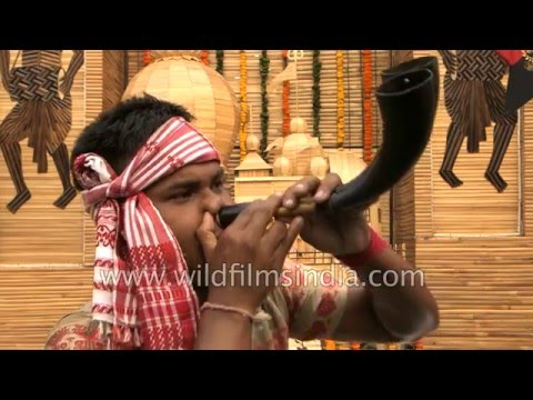 Indian blows buffalo horn instrument through his nose!