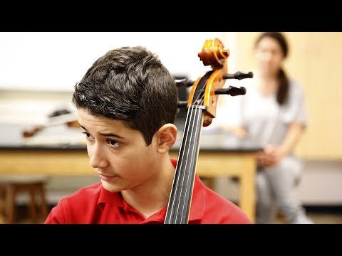 Zach Thibodeaux takes up the cello ahead of attending Bishop Dunne Catholic School