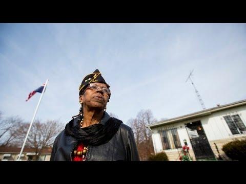 Veteran Flies Flag Upside Down In Flint