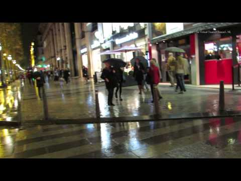 Walk along Avenue Des Champs Elysees in Paris at night in the rain 1