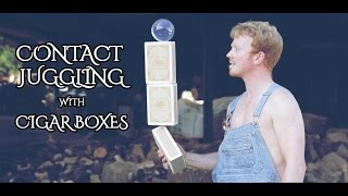 Ball & boxes - Contact juggling with Cigar Boxes - Ed Cliffe