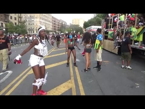 CARIBBEAN ISLANDS GIRLS DANCE TO REGGAE MUSIC AT CARIBBEAN SOUND SYSTEM MUSIC TRUCK AT CARNIVAL
