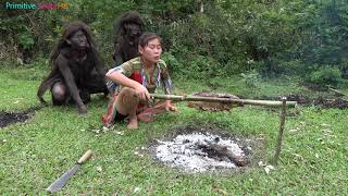 Primitive life - ethnic girl catch fish and grill fish meet forest people beggar