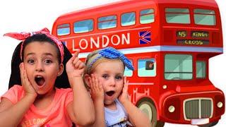 Wheels On The Bus - kids songs - Canción infantil en ingles con Melania y Laneya