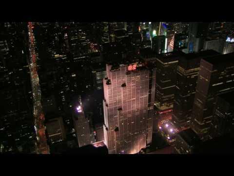 aerial night shot panning past new york ge building Wkl4g9gZS