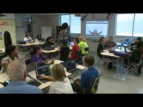 AACPS Digest - Rotary Club Donates Computers to Corkran Middle School