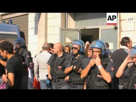 North African immigrants clash with police outside govt office