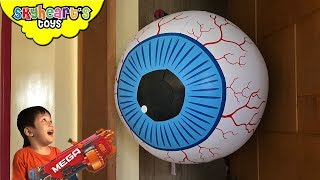 GIANT EYEBALL vs. Toddler Nerf War | Skyheart's Toys battle eye monster fight kids