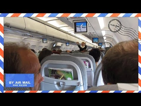 Finnair Airbus A321 takeoff from Helsinki Airport flying to Copenhagen - cabin view