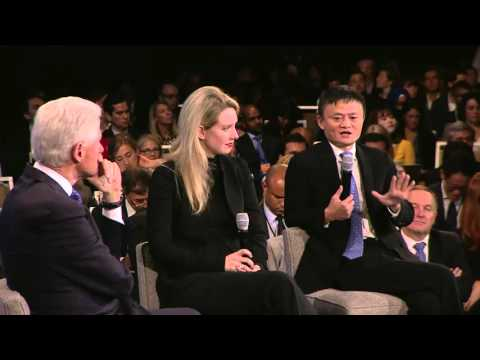 President Clinton speaks with Elizabeth Holmes and Jack Ma (
