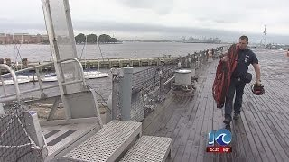 USS Wisconsin Sailors work with local firefighters