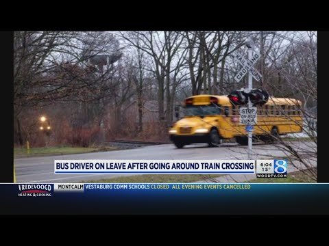 Plainwell bus crosses in front of train; driver on leave