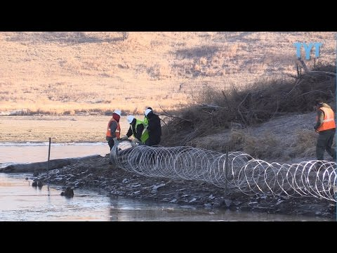 EXCLUSIVE: DAPL Builds Razor Wire Wall On Native Burial Ground