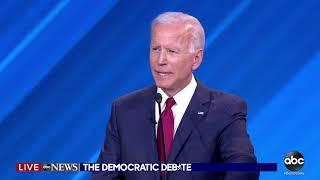 Protesters rush stage, interrupt Joe Biden at Democratic debate