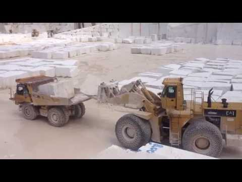 Caterpillar 992C Loader Loading Big Stones At Cat 769D Dumper - Marble Quarries