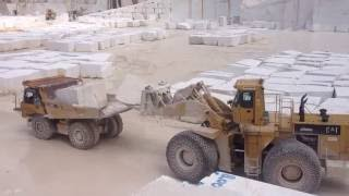 Caterpillar 992C Loader Loading Big Stones At Cat 769D Dumper - Marble Quarries