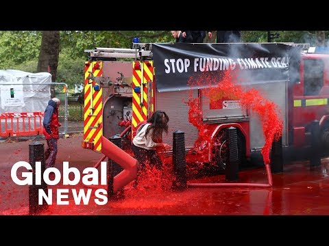 Leland Conway - LOL: Eco-Warriors Lose Control Of Fake Blood Fire Hose In Vandalism Stunt