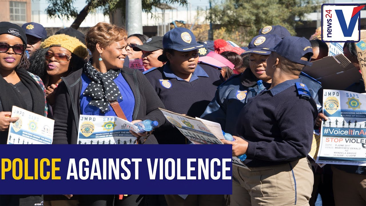 """Silence is no longer golden"" - South African Police drive the anti women and children march."