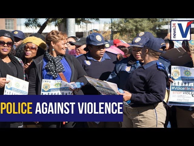 """""""Silence is no longer golden"""" - South African Police drive the anti women and children march."""