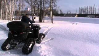 Квадроцикл на снегу(С такими гусенницами он едит гораздо лучше. +7 (495) 989-66-59 Установка гуссениц на квадроциклы., 2013-02-09T11:45:41.000Z)