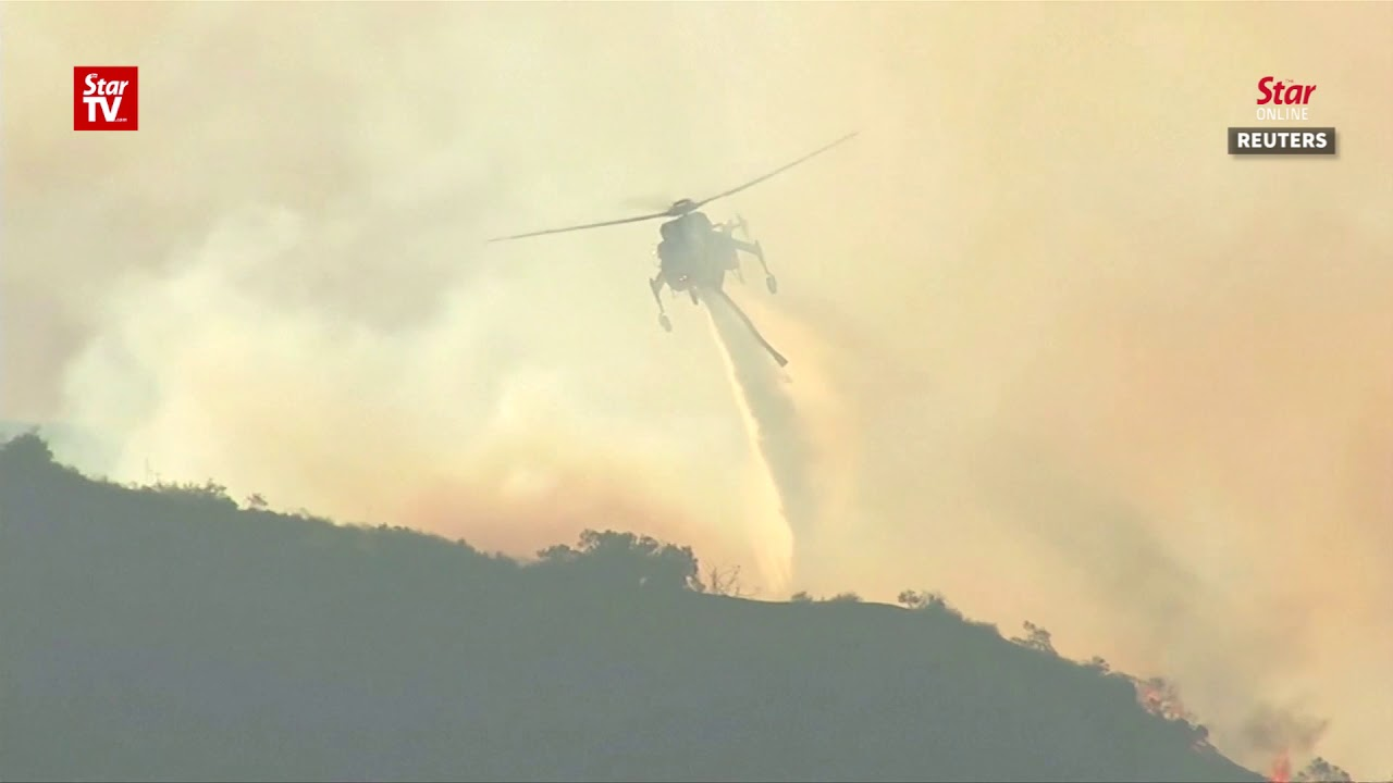 California wildfires rage on, threatening LA neighborhoods