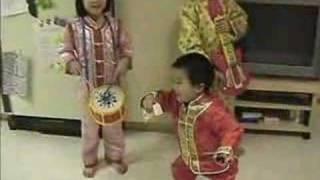 Three kids singing Chinese new year songs