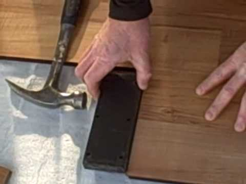 how to install laminate flooring part 1 tapping block. Black Bedroom Furniture Sets. Home Design Ideas