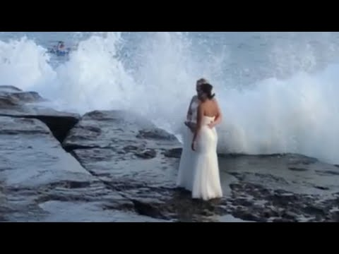 Couple Gets Wiped out by Wave During Wedding Photo Shoot
