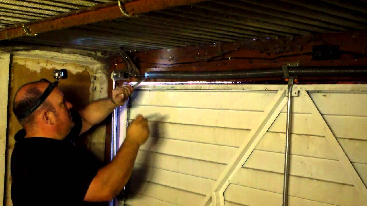 how to adjust garage door springsHow to adjust the spring tension on a garage door in Manchester