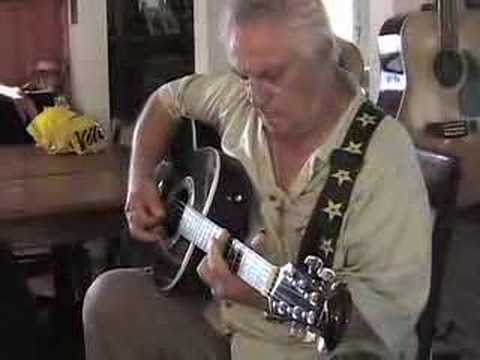 Tommy DeVito playing guitar