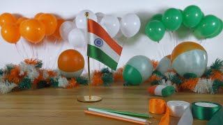 Closeup shot of Indian female placing tricolor flag - Independence/Republic day, India