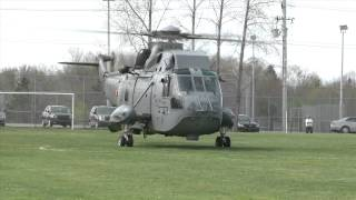 Cool Sea King Helicopter lifts off in soccer field
