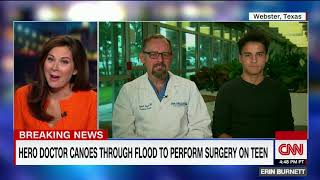 Doctor canoes through flood to perform surgery