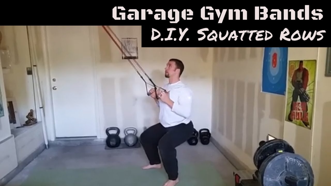 Squatted row with resistance band in garage gym youtube