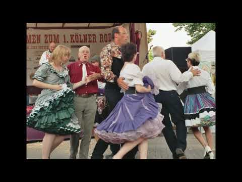 6.  The Settlers Dance (Square dancers & Caller)  - Voices