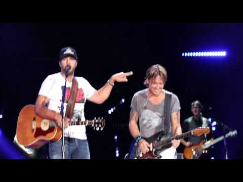 Luke Bryan Challenges Keith Urban's Guitar...