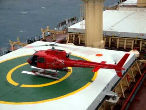 helicopter landing on ship at australia anchorage haypoint,mackay