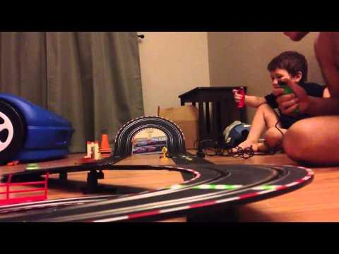 Playing with my son. Carrera slot car Disney Cars set