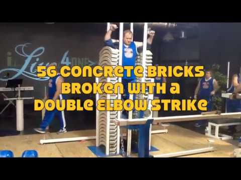 56 Concrete Bricks Broken with a Double Elbow Strike - Omega Force Strength Team