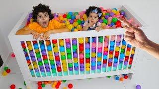 plastic balls in an amira crib