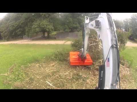 Bobcat Excavator Mower Devouring A Shrub Mulcher Grinder