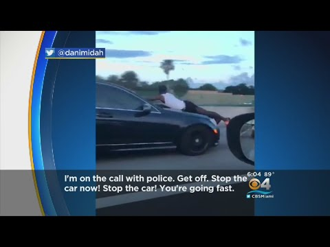 Police Release 911 Call On Man Riding Hood Of Car