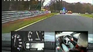 2 Supra's racing round oulton park, car infront is a Toyota.