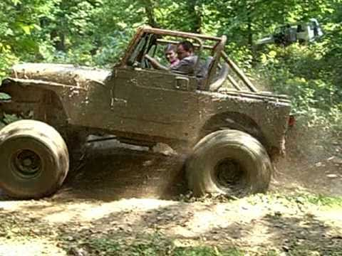 Jeep Wrangler Lifted >> Lifted Jeep in Deep Mud Hole - YouTube
