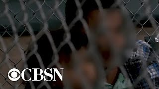 Border officials downplay conditions at migrant facilities