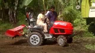 Kudumbasree worker driving KAMCO TERA TRAC Demo By KERALA AGRO Industries Corporation Vaikom