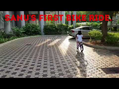 Sanu riding her bike for the first time on 2 wheels.