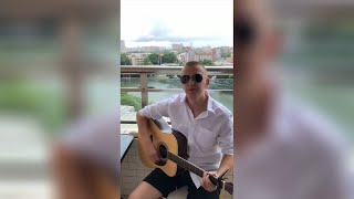 GLOBALink | Russian expat exudes positivity through songs during lockdown in Guangzhou, China