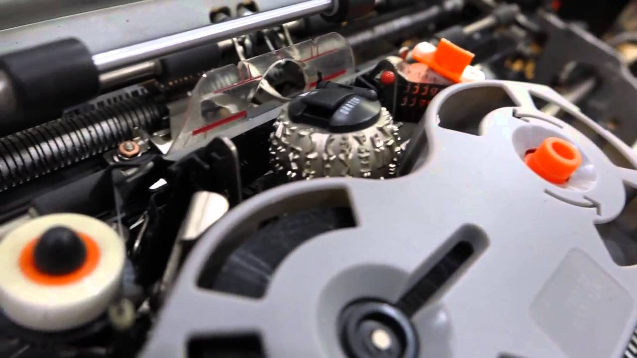 parts of a typewriter and its function